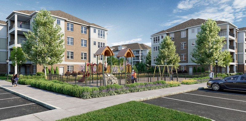 Rendering of apartment building and outdoor playground