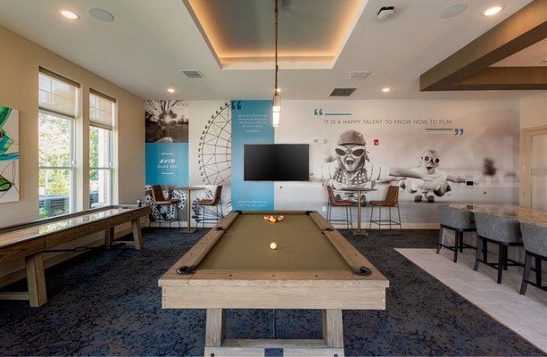 Game Room with billiards table and bar area