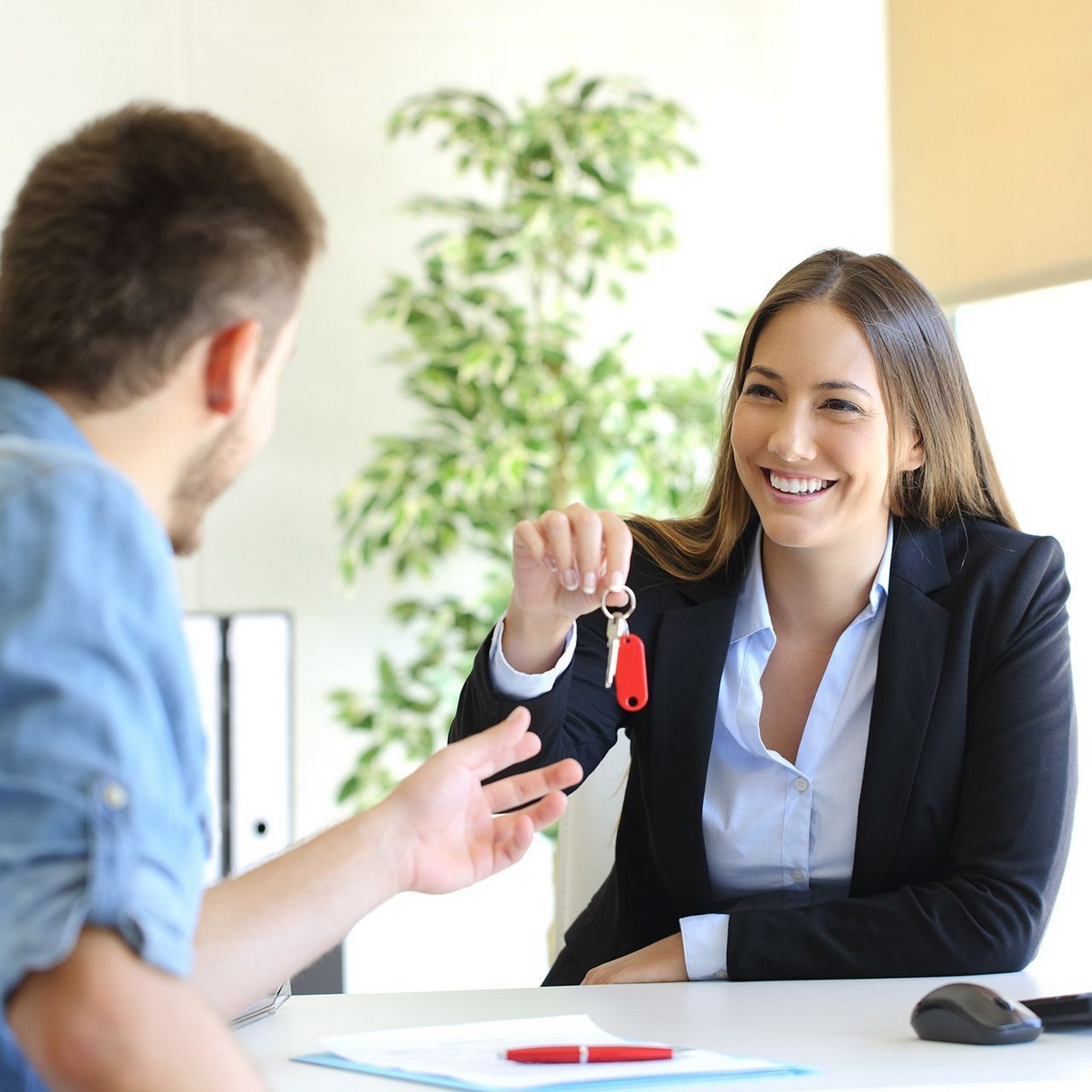leasing agent handing keys to a resident