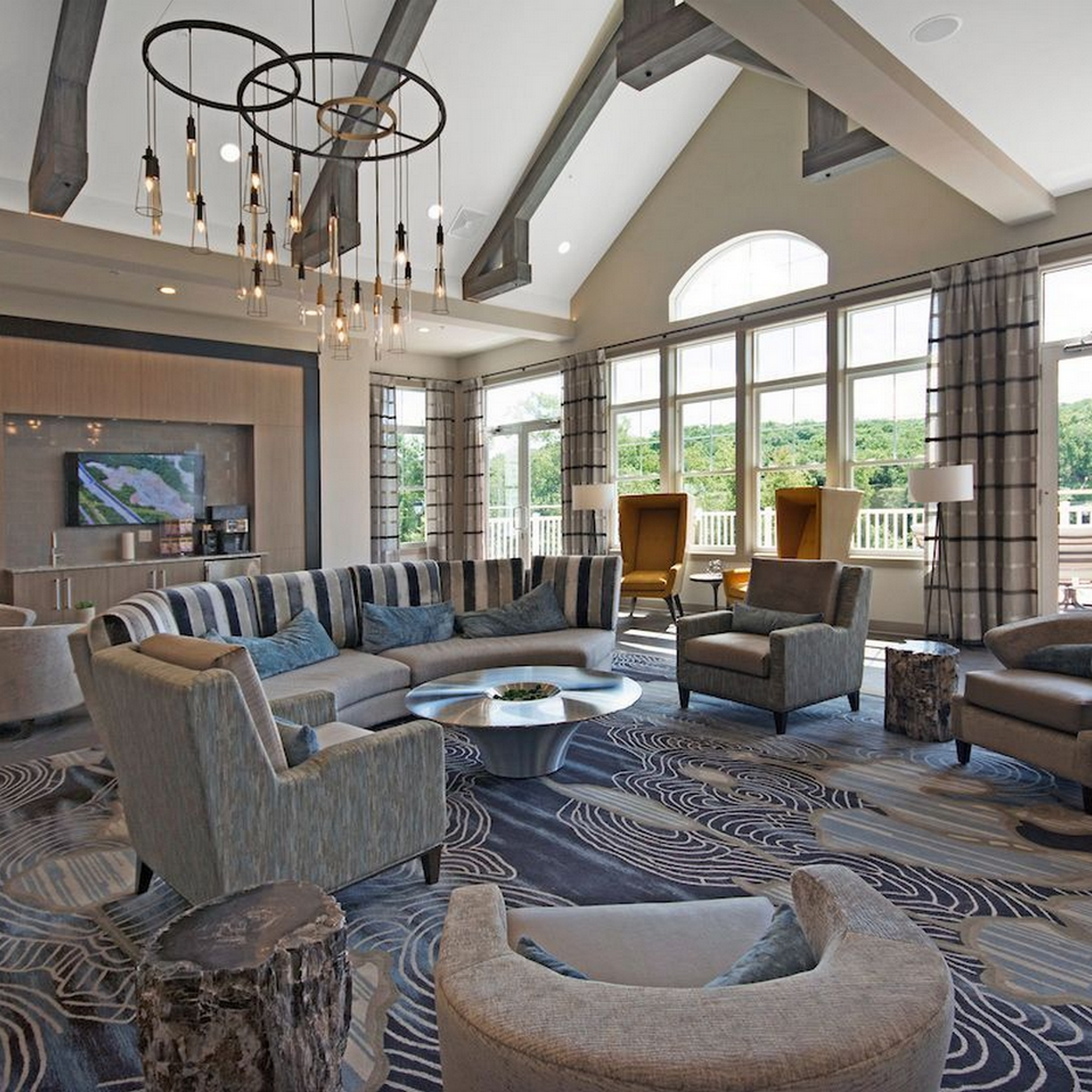 Resident Lounge, carpet, lounge chairs, chandelier, large floor to ceiling windows, neutral colors