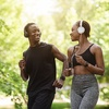 Couple jogging while listening to music on headphones