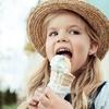Little girl eating ice cream cone