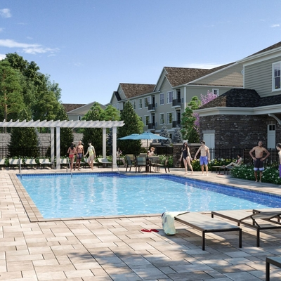 Outdoor image of pool and apartment building with lounge chairs with umbrella