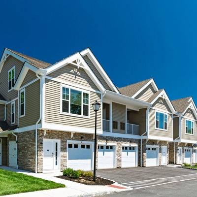 Exterior image of apartments with garage units underneath apartment units