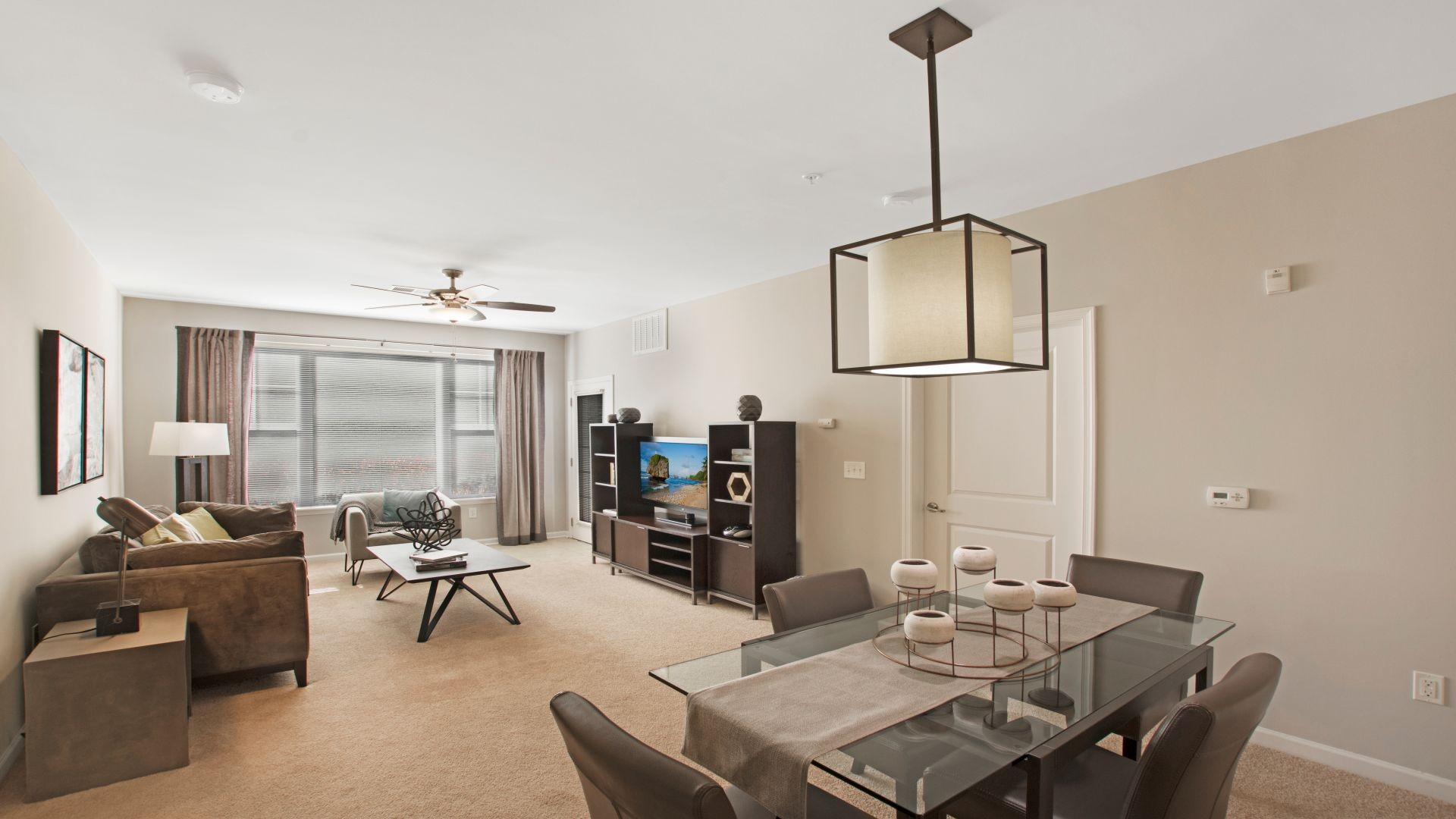 Interior image apartment living room with furniture and dining table with chairs