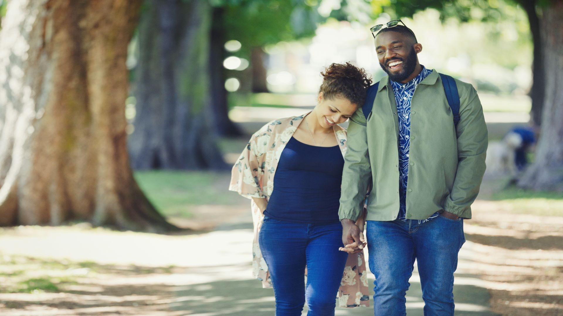 Image of woman and man walking together in a park