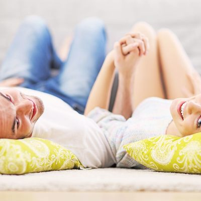 Couple laying down and holding hands