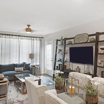 Apartment living area with seating and television