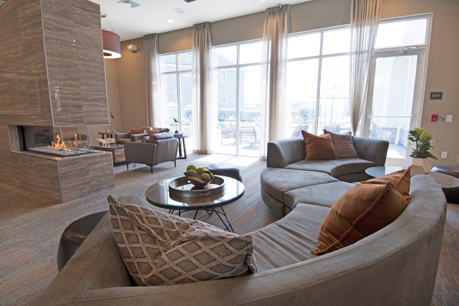Upscale clubhouse seating and coffee tables with modern fireplace